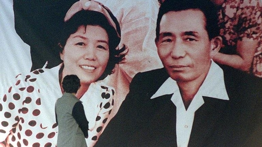 Photos of former South Korean president Park Chung-Hee and his wife is displayed on a wall in Seoul in 1999. Park, a military strongman who seized power in a military coup, was assassinated in 1979, not by North Koreans but at the hands of his own security chief.