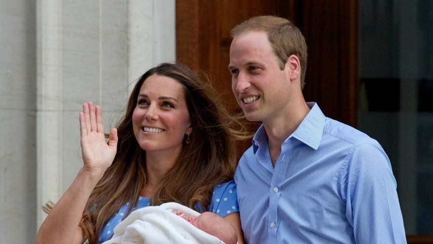 Prince William and Catherine, Duchess of Cambridge show their newborn boy to the world's media outside the Lindo Wing of St Mary's Hospital in London on July 23, 2013. The couple and their son were spending their first day at home as a family Wednesday, a day after the royal couple showed off the future monarch to the world.