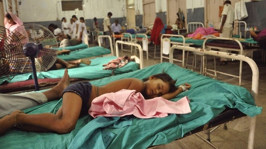 July 17, 2013: In this file photograph, Indian children who fell sick after eating a free school lunch lie at a hospital in Patna, India.