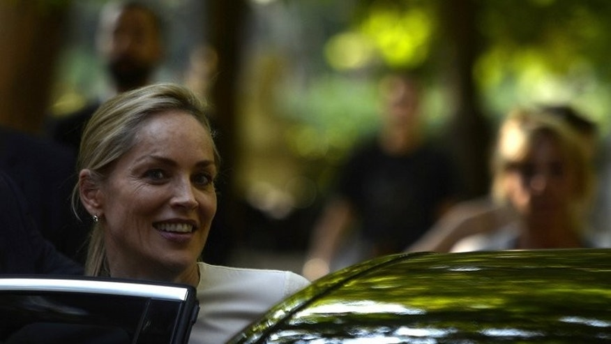 "US actress Sharon Stone leaves the set of movie ""Un ragazzo d'oro"" (A golden boy) in Rome on July 22, 2013. Stone and Cat Stevens will take part in a musical in September honouring an environmental group founded by former Soviet leader Mikhail Gorbachev, organisers said Wednesday."
