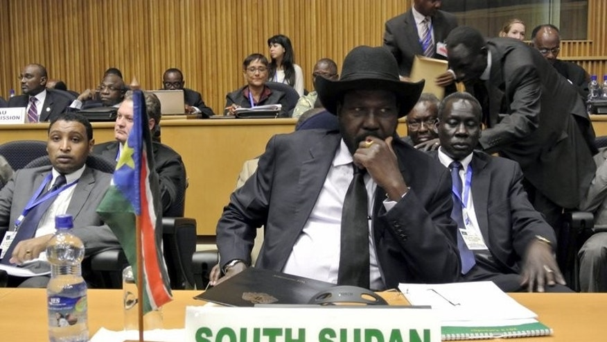 South Sudanese President Salva Kiir waits on January 25, 2013 in Addis Ababa for the start a security meeting at the African Union. Heavily armed South Sudanese troops and police guarded key government institutions in the capital Juba Wednesday, as radio broadcasts called for calm after the president suspended his cabinet.