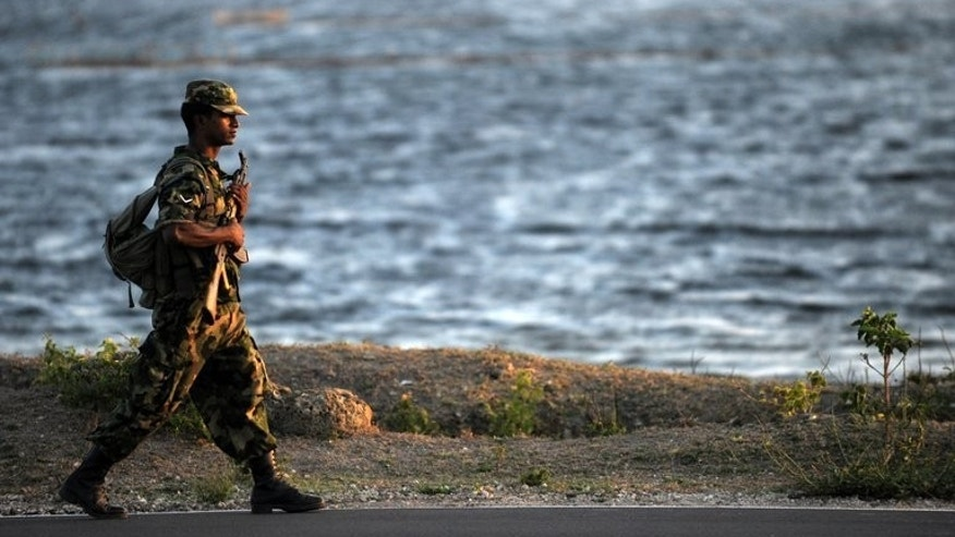 A Sri Lankan army trooper patrols the island's northern town of Jaffna on September 18, 2011. Sri Lanka's military said Wednesday it will dismantle over a dozen army camps in the former rebel stronghold of Jaffna, weeks ahead of key council elections in the embattled region.