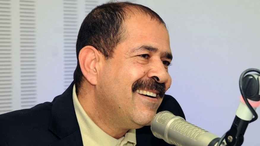 A picture taken on November 20, 2012 shows late Tunisian lawyer Chokri Belaid speaking during a radio interview in Tunis. Six people believed to have orchestrated the killing of an opposition figure whose assassination in February plunged Tunisia into a major political crisis have been identified, a minister said Wednesday.