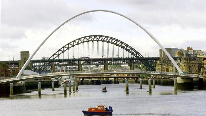 File picture shows the Millennium Bridge across the River Tyne in front of the famous Tyne Bridge in Newcastle, September 5, 2001. Police divers on Tuesday recovered two bodies in the search for a pair of teenage girls who were last seen in difficulties in the River Tyne.