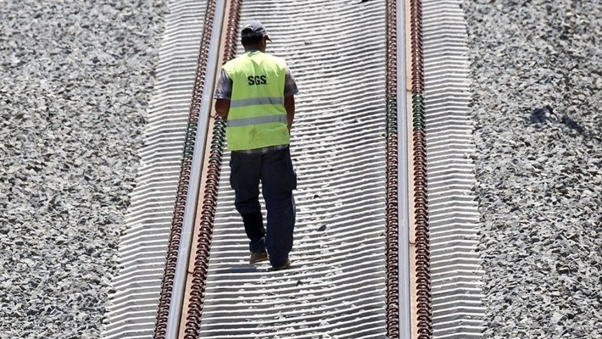 An employee of the Spanish National Railway Company (RENFE) is seen on the tracks in Valencia on June 23, 2010. Between 15 and 20 people have died after a train derailed in northwestern Spain on Wednesday, according to the El Pais and El Mundo dailies.