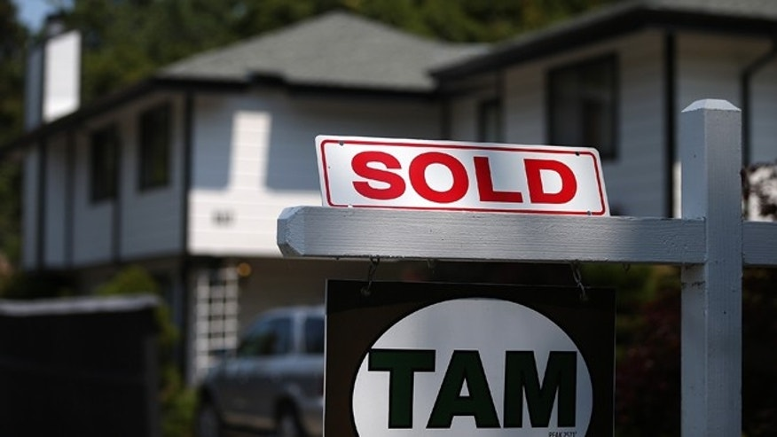 SAN ANSELMO, CA - JULY 02:  A sold sign is posted in front of a home for sale on July 2, 2013 in San Anselmo, California.  According to a report by real estate data provider CoreLogic, home prices in the U.S. surged 12.2 percent in May compared to a year ago, the largest increase in seven years. (Photo by Justin Sullivan/Getty Images)