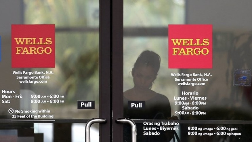 A customer leaves a Wells Fargo bank branch office on July 12, 2012 in Daly City, California. The Industrial & Commercial Bank of China (ICBC) has lost its standing as the world's largest bank by market capitalisation to US-based Wells Fargo, data showed Wednesday, as China's economy slows.