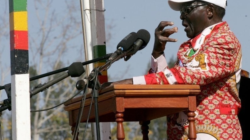 Zimbabwe's president and Zanu PF presidential candidate Robert Mugabe speaks at a election campaign rally in Chinhoyi in Mashonaland West, Zimbabwe on July 18, 2013. Mugabe has vowed to extend his 33-year-rule and beat bitter rival Prime Minister Morgan Tsvangirai at the polls on July 31.