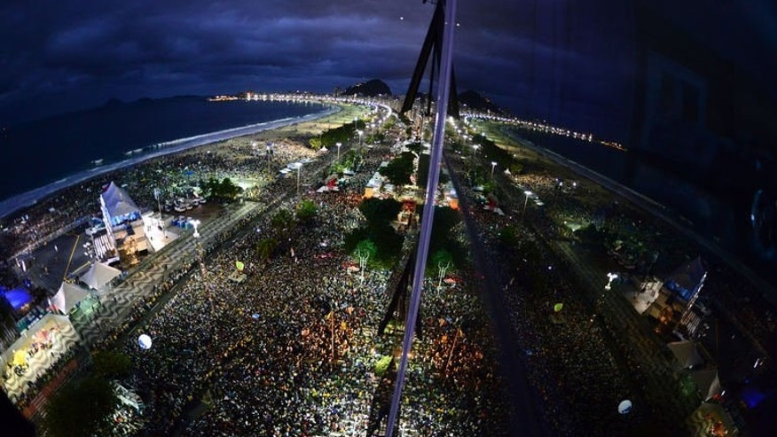 A huge crowd of 1.5 million Catholics greeted Pope Francis on Brazil's Copacabana beach after the pontiff toured a notorious Rio slum to defend the cause of the poor on July 25, 2013.