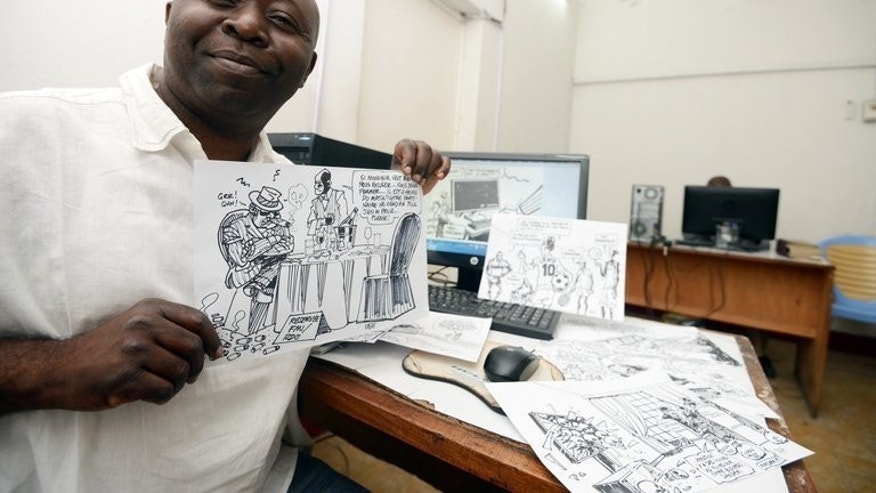 Congolese cartoonist for daily newspaper Le Potentiel, Kashoun Thembo, also known as Kash, poses for a photograph on July 18, 2013 in Kinshasa. The headlines out of the Democratic Republic of Congo, which tend to evoke images of bloodshed, rape, ethnic hatred and corruption, are usually no laughing matter, but Kash is an expert at wringing humour out of his country's tragedies.