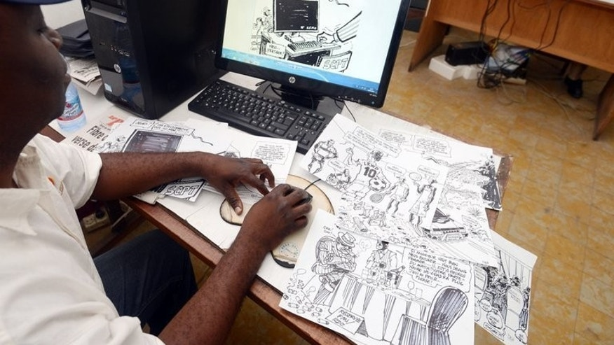 Congolese cartoonist for daily newspaper Le Potentiel, Kashoun Thembo, also known as Kash, works at his office on July 18, 2013 in Kinshasa. The headlines out of the Democratic Republic of Congo, which tend to evoke images of bloodshed, rape, ethnic hatred and corruption, are usually no laughing matter, but Kash is an expert at wringing humour out of his country's tragedies.