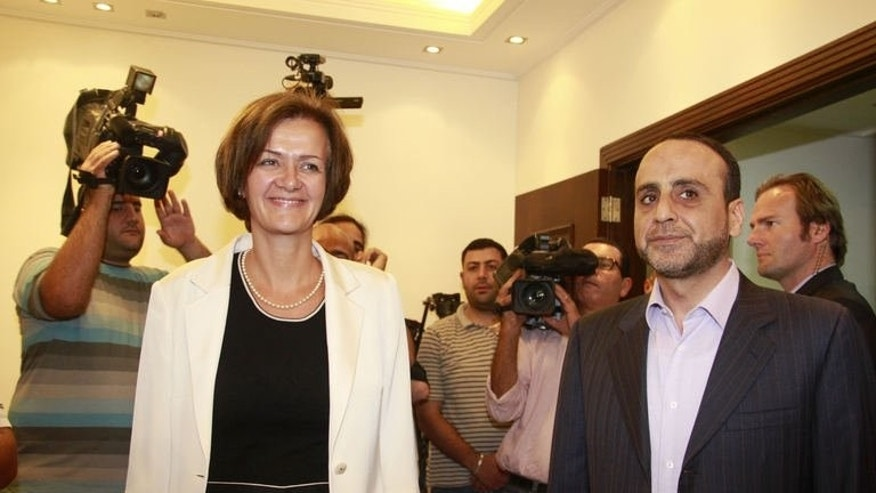 Ambassador of the European Union to Lebanon, Angelina Eichhorst (L) and head of Hezbollah's International Relations, Ammar al-Mussawi leave after a meeting following European Union's decision to blacklist Hezbollah's armed wing on July 25, 2013 in the Lebanese capital Beirut.