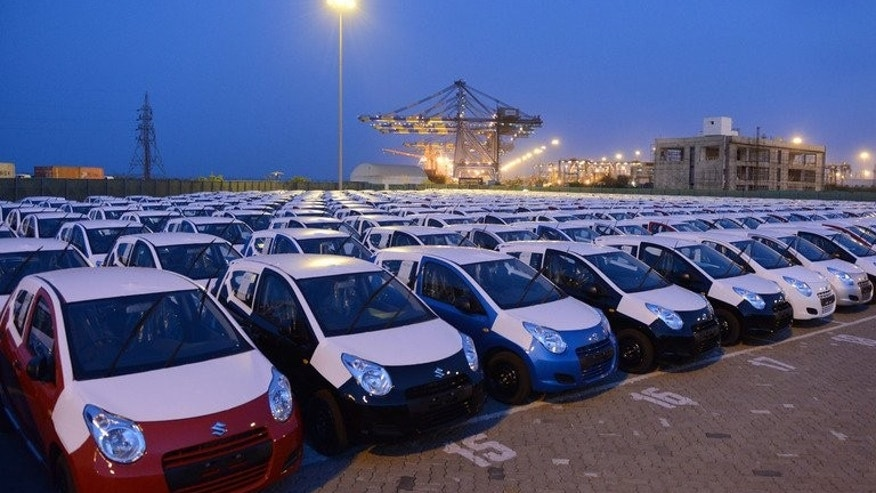 Maruti Suzuki Alto cars to be exported out of India are parked in a holding area at Adani Ports and Special Economic Zone (APSEZ) in Mundra, India. Maruti Suzuki, India's biggest carmaker by sales, Thursday reported a 49 percent jump in first-quarter net profit as cheaper imports of parts offset a drop in sales.