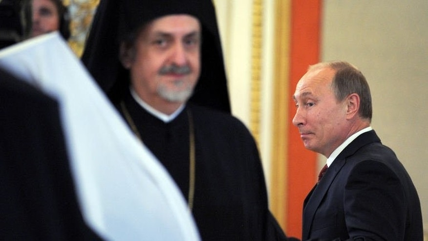 Russia President Vladimir Putin arrives for a meeting with Orthodox leaders at the Kremlin in Moscow on July 25, 2013.