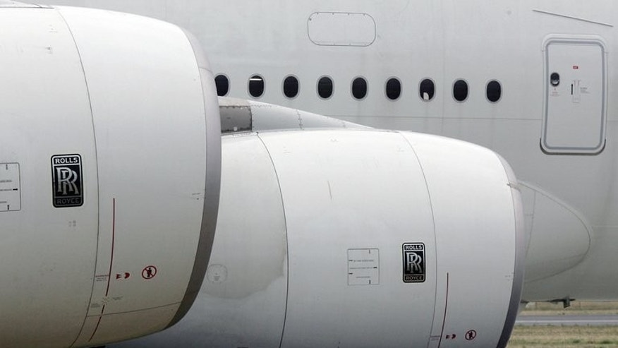 Rolls-Royce recorded a net loss in the first half of 2013 compared with a profit after tax one year earlier on changes to finance costs, the maker of aircraft engines said Thursday.