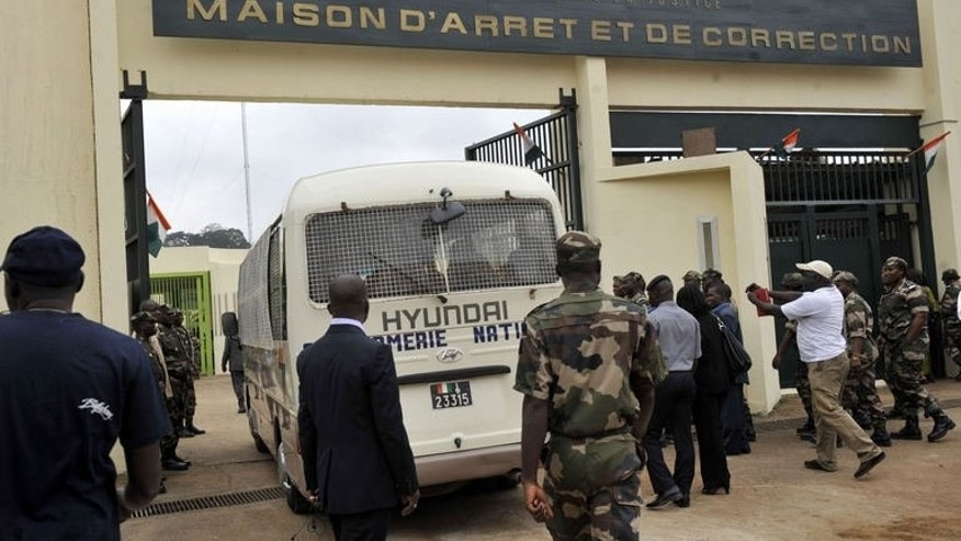 A police van enters the gates of the Maca prison in Abidjan, Ivory Coast, on August 16, 2011. At least six prisoners have died and several others, including guards, were injured during an attempted breakout from the jail, security sources say.