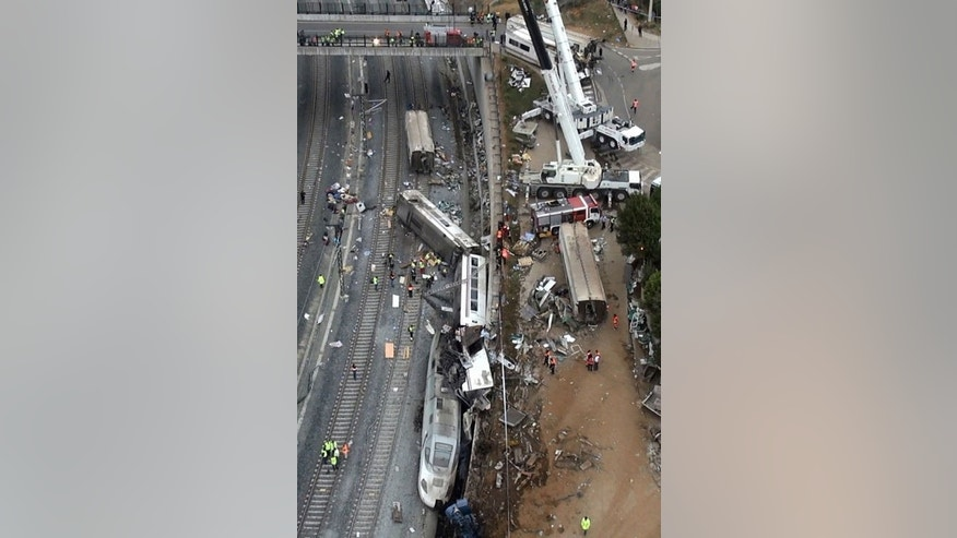 An aerial view shows the site of a train accident near the city of Santiago de Compostela on July 25, 2013. Spanish police were waiting Friday to question one of the drivers of the train that derailed, killing at least 80 passengers, amid media reports it was travelling at twice the speed limit.