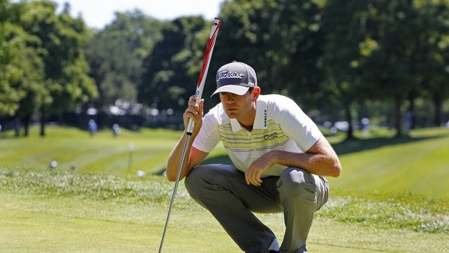 Brendan Steele of the United States lines up his putt on the ninth hole during round one of the RBC Canadian Open at Glen Abbey Golf Club on July 25, 2013 in Oakville, Ontario, Canada. Steele carded eight birdies in a seven-under-par 65 to seize the first-round lead