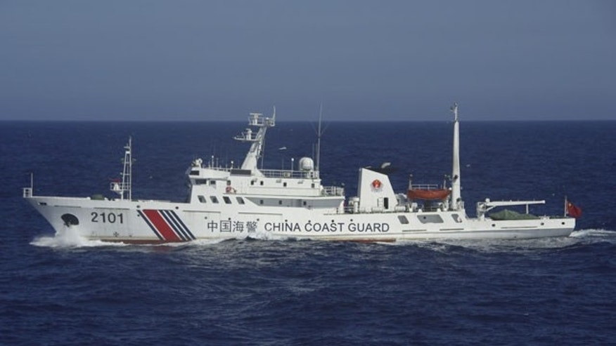 July 24, 2013: In this photo released by Japan's 11th Regional Coast Guard, a China Coast Guard ship numbered 2101 sails in waters 66 kilometers (41 miles) from the East China Sea islands called Senkaku by Japan and Diaoyu by China (AP Photo/Japan's 11th Regional Coast Guard)