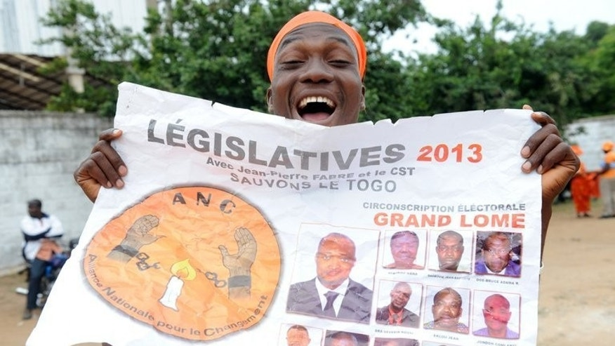 A supporter of opposition leader Jean-Pierre Fabre, of Collective Save Togo (CST), rallies in Lome on July 23, 2013. Polls have opened in parliamentary elections delayed by months of protests, with the opposition seeking to weaken the ruling family's decades-long grip on power in the west African nation.