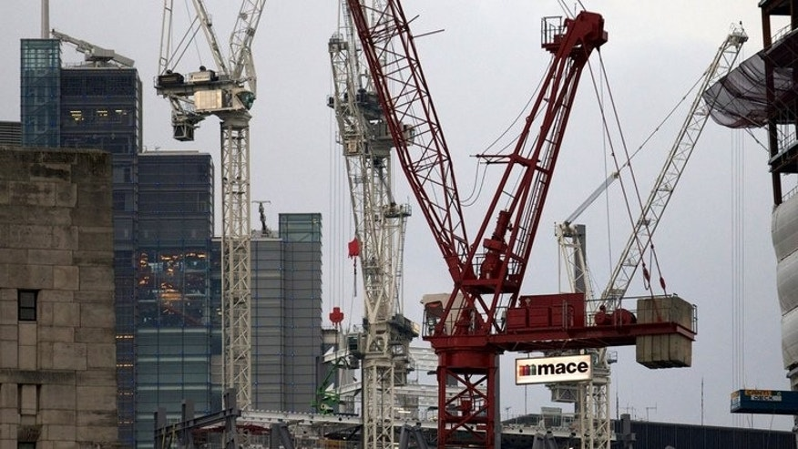 Construction work progresses on the new Leadenhall building in central London, October 25, 2012. Britain's economy grew at an accelerated pace of 0.6 percent in the second quarter compared with output in the first three months of the year, building on the country's recovery, official data shows.