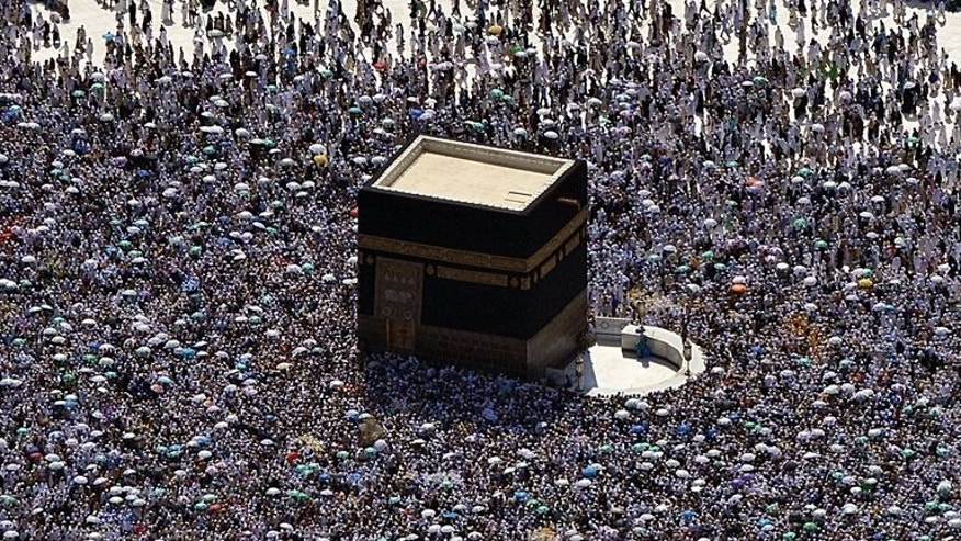 An aerial view shows hajj pilgrims circling the Kaaba at the Grand mosque in Mecca, on October 27, 2012. Fears of an outbreak of the deadly MERS virus in Saudi Arabia and construction in the holy city of Mecca have forced cuts in the numbers of pilgrims permitted to perform this year's hajj.