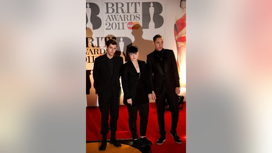 UK band 'The XX' (from L) Jamie Smith, Madley Croft and Oliver Sim arrive at the O2 arena in east London, ahead of the Brit Awards, on February 15, 2011. With their sparse guitar lines, hushed vocals and enigmatic stage presence, The xx are a band who have come to personify cool understatement.