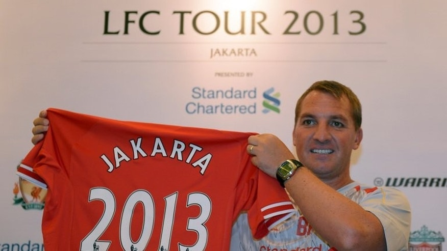 Brendan Rodgers holds a Liverpool jersey during a press conference in Jakarta last week. In Jakarta, Liverpool fans are so well-versed that when 'You'll Never Walk Alone' rang out around the cavernous Gelora Bung Karno Stadium, it was in a pitch-perfect Scouse accent.