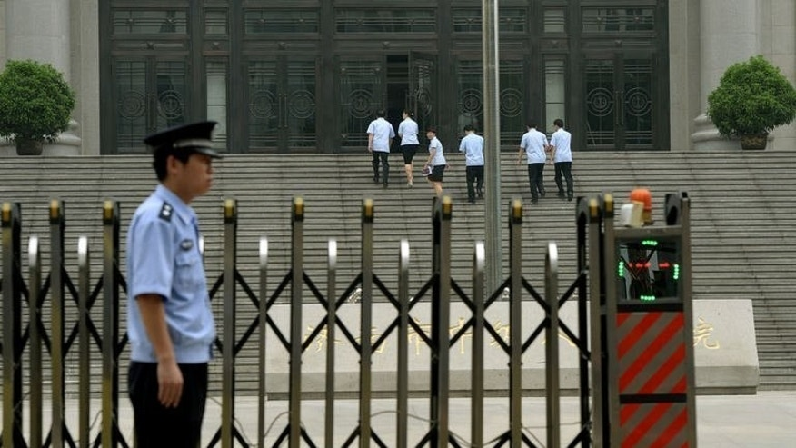 Police stand guard outside the Intermediate People's Court where Chinese politician Bo Xilai was indicted and his case expected to be heard, in Jinan, China's Shandong province, on July 25, 2013. The high-flying communist politician was indicted for bribery and abuse of power, following a scandal that exposed deep divisions at the highest levels of government.