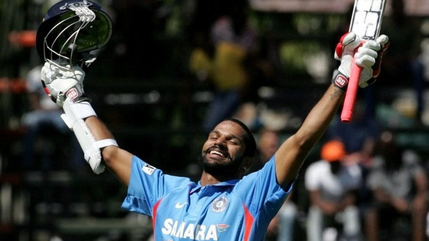 India's batsman Shikhar Dhawan celebrates his century during the 2nd match of the 5-match ODI series between hosts Zimbabwe and India, at Harare Sports Club, on July 26, 2013.