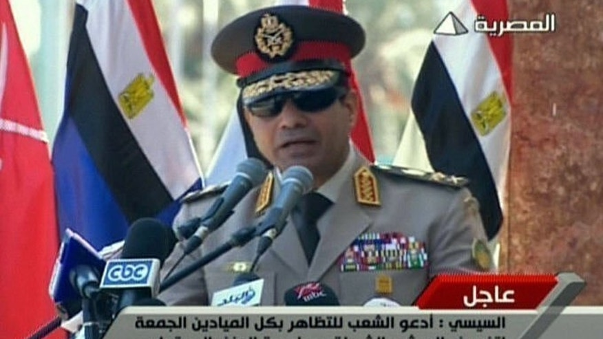 "Image grab taken from state TV shows Egypt's army chief General Abdel Fattah al-Sisi giving a live broadcast calling for public rallies to give him a mandate to fight ""terrorism and violence"", July 24, 2013. Egypt's military insisted on Thursday it was not targeting backers of ousted president Mohamed Morsi in calling for a mass rally to counter 'terrorism', amid outrage from Islamist protesters."