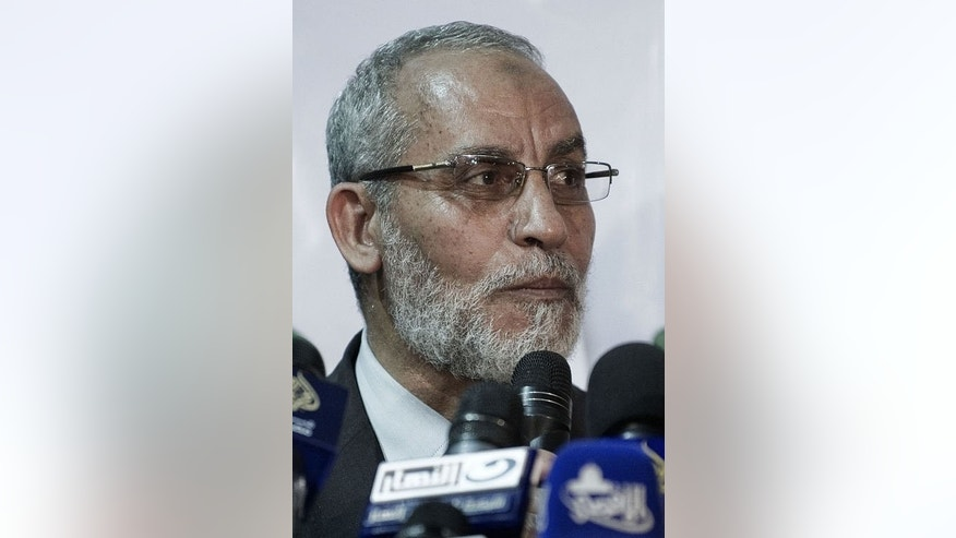 "File picture shows Mohamed Badei, leader of Egypt's Muslim brotherhood, at a press conference in Cairo on March 31, 2012. The fugitive leader of Morsi's Muslim Brotherhood on Thursday urged Egyptians to peacefully make a ""stand for freedom and legitimacy, and against the bloody coup."""