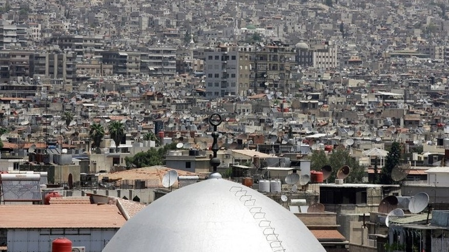 The dome of a mosque is seen amongst the skyling of the Syrian capital Damascus on June 26, 2013. A Franco-American photographer who had been detained in Syria since April has been freed and arrived safely in Paris this week, the French foreign ministry said.