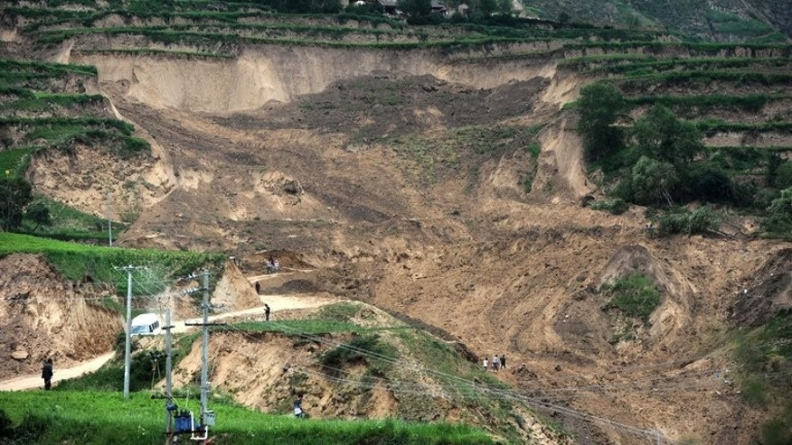 Debris left by a landslide triggered after the recent earthquakes in Minxian county in Dingxi, northwest China's Gansu province, seen on July 24, 2013. Nine people were buried and four missing after landslides hit Gansu province where at least 95 were killed this week by the quakes, state media reported on Friday.