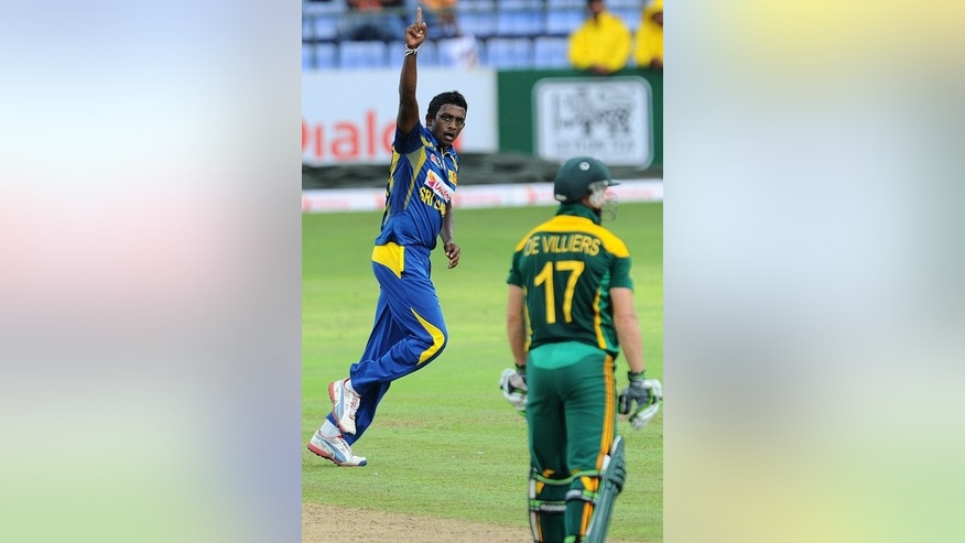 Ajantha Mendis (left) celebrates the wicket AB de Villiers in Pallekele on Friday. Mendis bowled both Farhaan Behardien and Robin Peterson, and had danger man de Villiers caught behind to finish with three for 35 from his 10 overs.