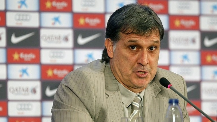"Barcelona's new coach Gerardo ""Tata"" Martino gives a press conference at Nou Camp on Friday. Martino, officially unveiled as Barcelona's new manager on Friday, wasted no time in telling Manchester United that Cesc Fabregas was not for sale."