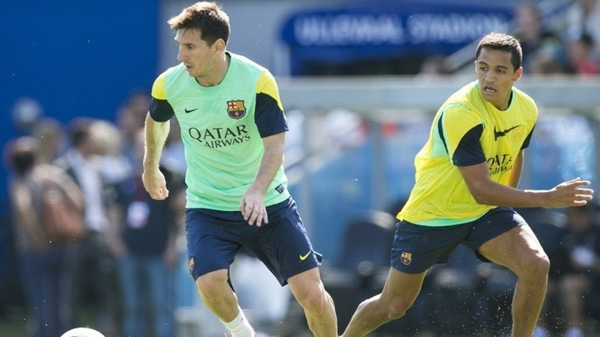 "Lionel Messi and Alexis Sanchez take part in a Barcelona training session at Ullevaal stadion in Oslo on Friday. New coach Gerardo Martino says Messi ""will continue to play in exactly the same position."""