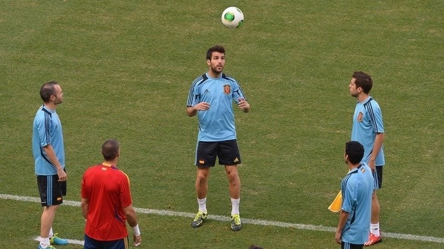 Cesc Fabregas (centre) heads the ball during a Spain training session in Fortaleza, Brazil, on June 26.