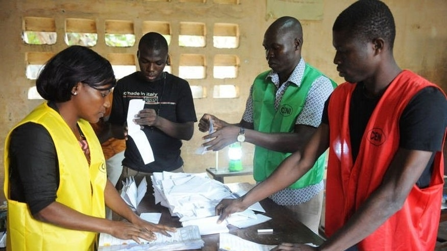 Members of Togo's Independent National Electoral Commission (CENI) sort votes on July 25, 2013 in Lome. The long-delayed parliamentary elections were mainly peaceful with the opposition seeking to weaken the ruling family's decades-long grip on power.