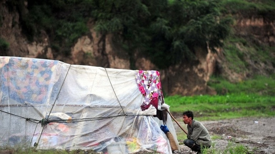 A picture from Thursday of a makeshift tent built by earthquake survivors in Minxian in Dingxi, Gansu province. At least 21 people have been killed and four reported missing in floods and mudslides that hit a Chinese province where at least 95 others died this week in twin earthquakes, state media reported on Saturday.