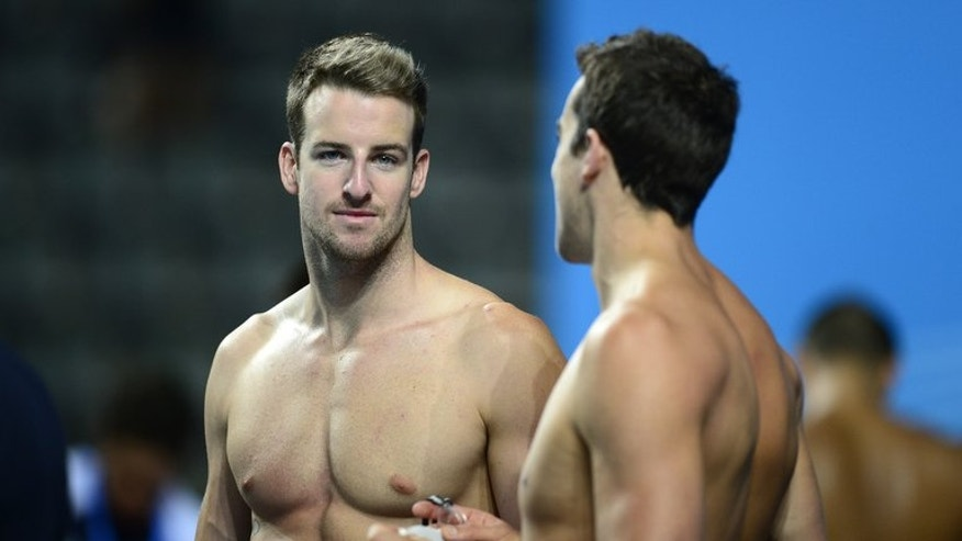 Australian swimmer James Magnussen (L) talks with teammate Matthew Abood during a training session on the eve of the swimming competition at the FINA World Championships, at the Palau Sant Jordi in Barcelona, on July 27, 2013. Magnussen-led Aussie team is seeking redemption for an under-achieving London Olympics, and the tumultuous 12 months which followed.