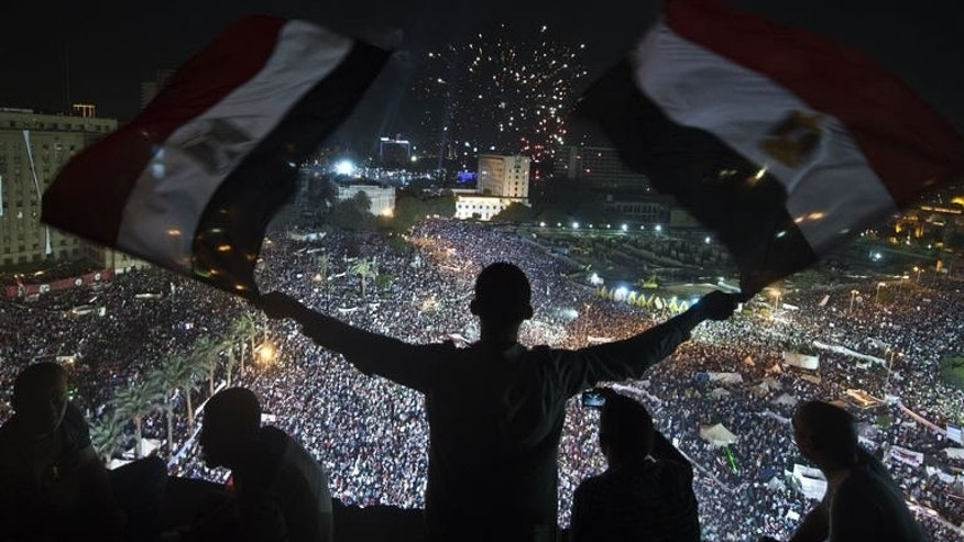 Supporters of Egyptian Armed Forces General Ahmed Fattah al-Sissi rally at Tahrir Square in Cairo on July 26, 2013. Mass rallies by supporters and opponents of Mohamed Morsi swept Egypt, as the authorities formally detained the ousted Islamist president accusing him of conspiring with the Palestinian group Hamas.