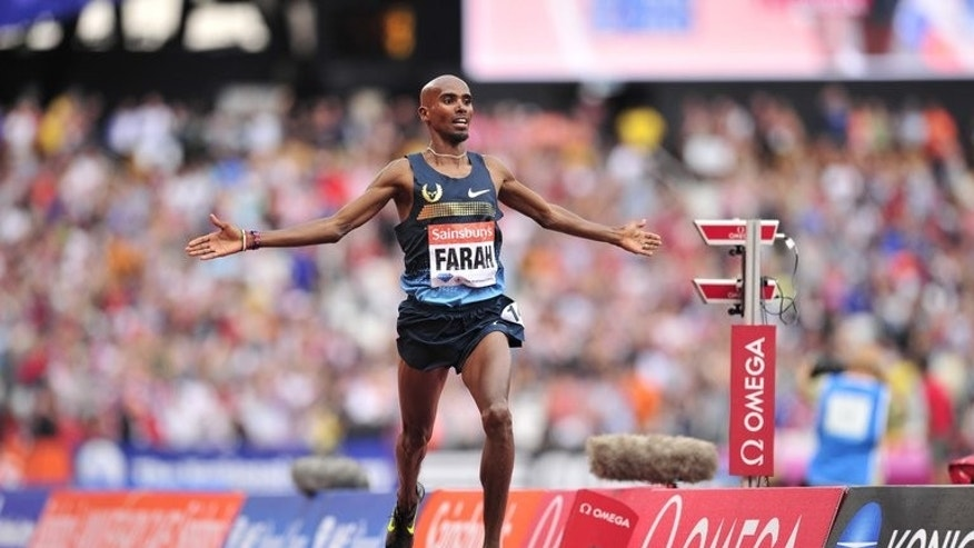 Mo Farah of Great Britain competes in the mens 3000 metres event during the London Anniversary Games International Association of Athletics Federations (IAAF) Diamond League International Athletics championships at the Olympic Stadium in London on July 27, 2013.