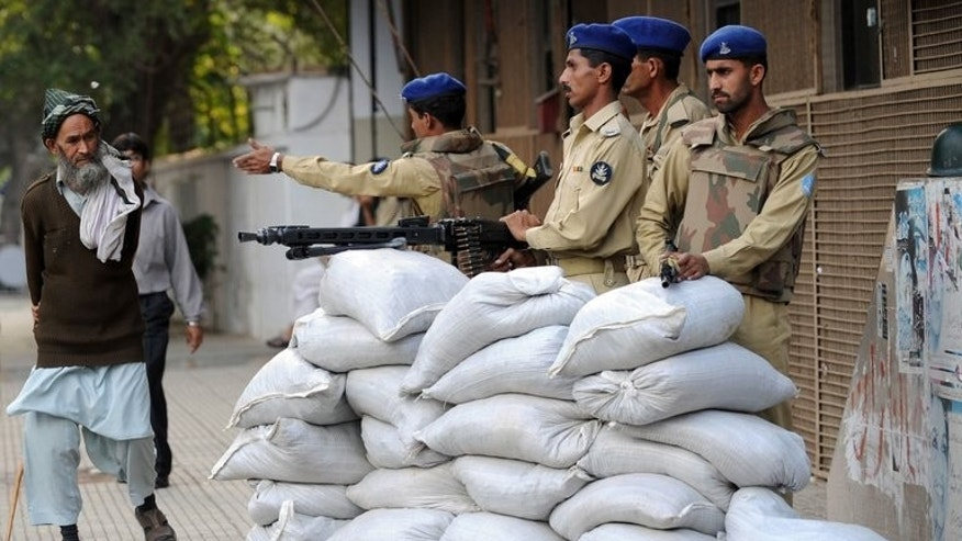 Paramilitary coastguards at a sandbag bunker outside the coastguard building in Karachi in 2008. A coastguard checkpoint was attacked on Saturday in the Suntsar area of Gwadar district, 1,420 kilometres (882 miles) southwest of Quetta, the capital of the oil and gas rich Baluchistan province that borders Iran and Afghanistan.