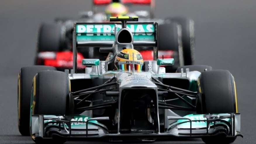 Mercedes' British driver Lewis Hamilton drives during the qualifying session at the Hungaroring circuit in Budapest on July 27, 2013 ahead of the Hungarian Formula One Grand Prix. Hamilton scorched to a surprise pole for the Hungarian Grand Prix in searing heat, the Mercedes driver edging out defending champion and season leader Sebastian Vettel.