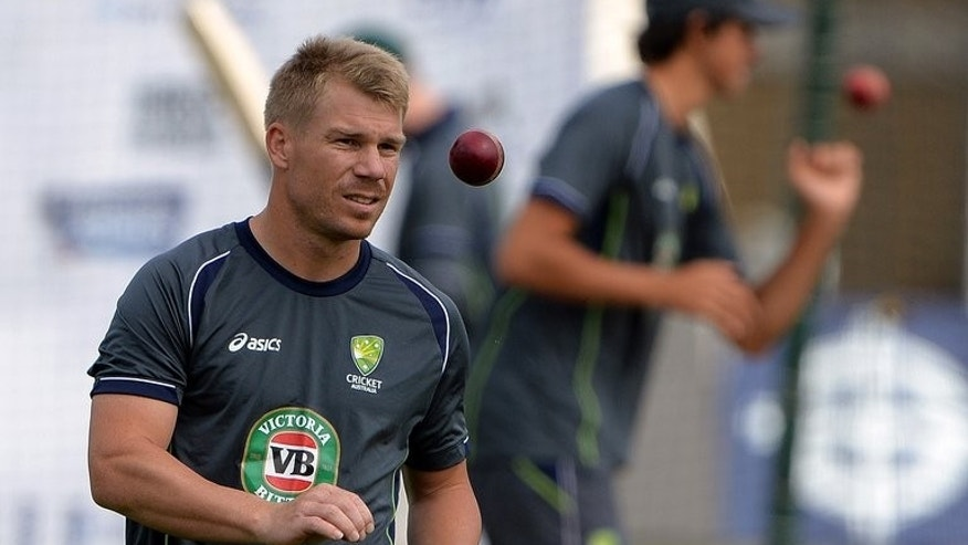 Australia's David Warner attends a practice session at Trent Bridge in Nottingham, central England on July 8, 2013. Warner had to be separated from South Africa A wicketkeeper Thami Tsolekile during his 33-run second innings Saturday.