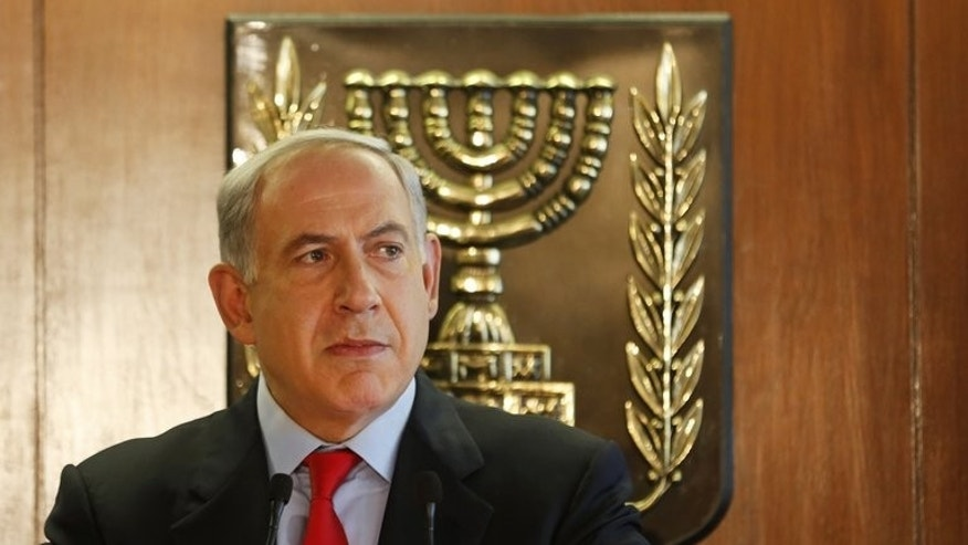 Israel's Prime Minister Benjamin Netanyahu speaks at the Knesset in Jerusalem on July 22, 2013. Netanyahu said on Saturday that Israel will free 104 Palestinian prisoners to coincide with the resumption of long-stalled peace talks.