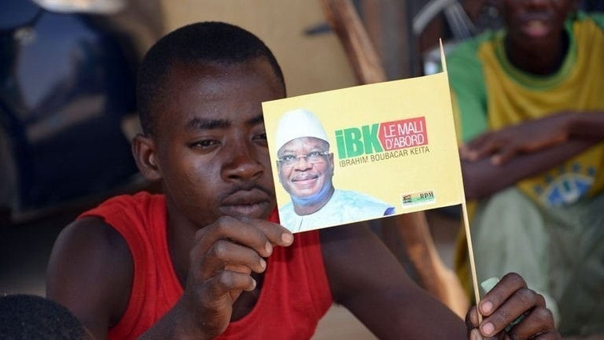 A young supporter of presidential candidate Ibrahim Boubacar Keita, attends an electoral meeting in Gao, northern Mali on July 26, 2013.