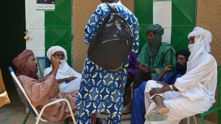"""A group of Tuareg militants, supporting presidential candidate Soumaila Cisse speak in Gao on July 26, 2013. Millions of Malians are expected to vote Sunday in """"imperfect"""" elections they hope will usher in a new dawn of peace and stability in a country torn apart by an 18-month political crisis and armed conflict."""