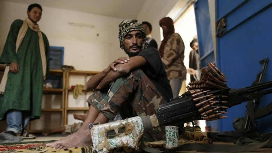 A soldier of the High Council for the Unity of Azawad sits in his quarters on July 27, 2013, in Kidal, northern Mali. The country is voting for the first time since last year's military coup upended one of the region's most stable democracies.